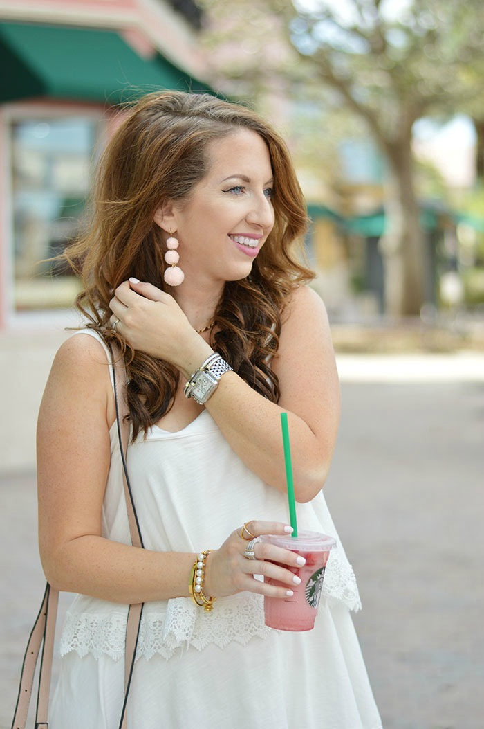 nina lacher from law of fashion blog wearing baublebar pom pom crispin earrings