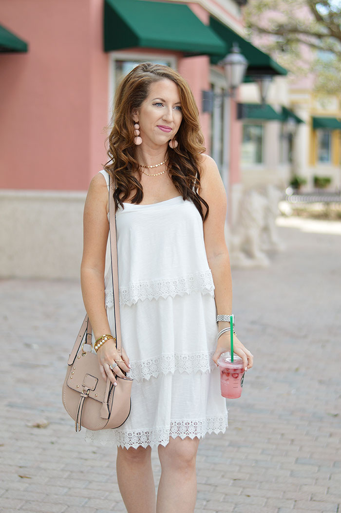 nina lacher from law of fashion blog wearing sole society faux leather studded cross body