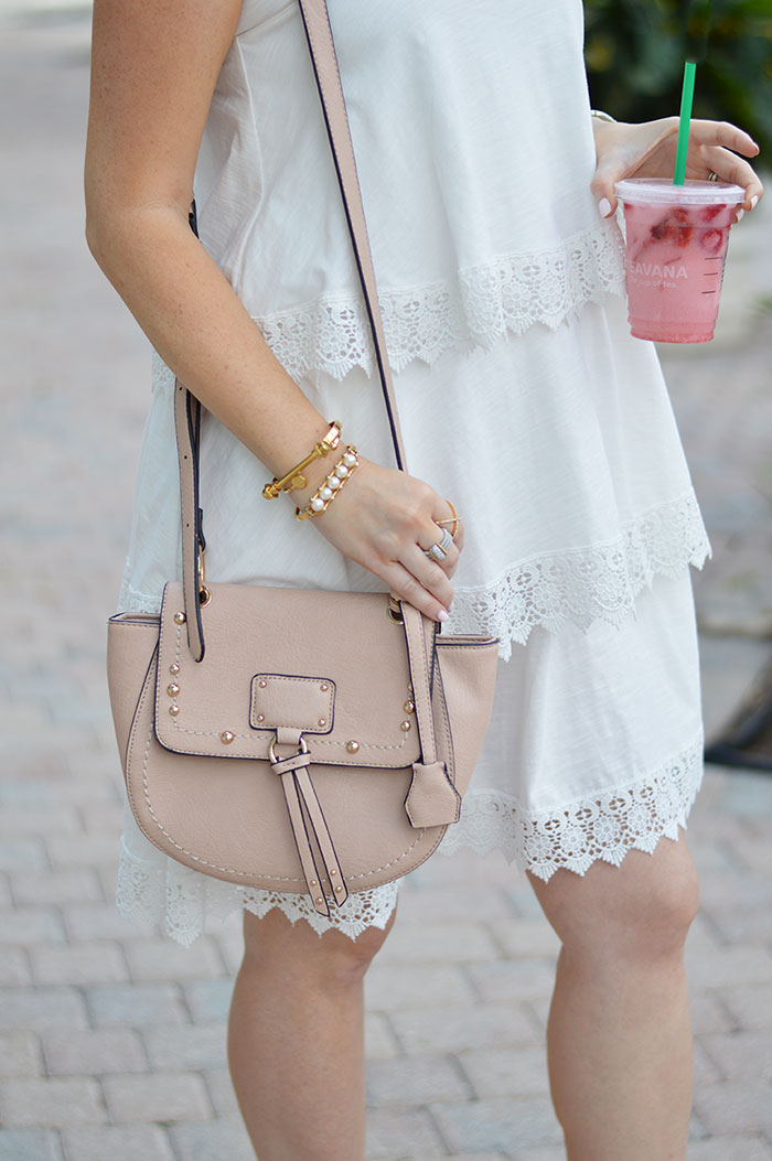 nina lacher from law of fashion blog wearing sole society studded faux cross body