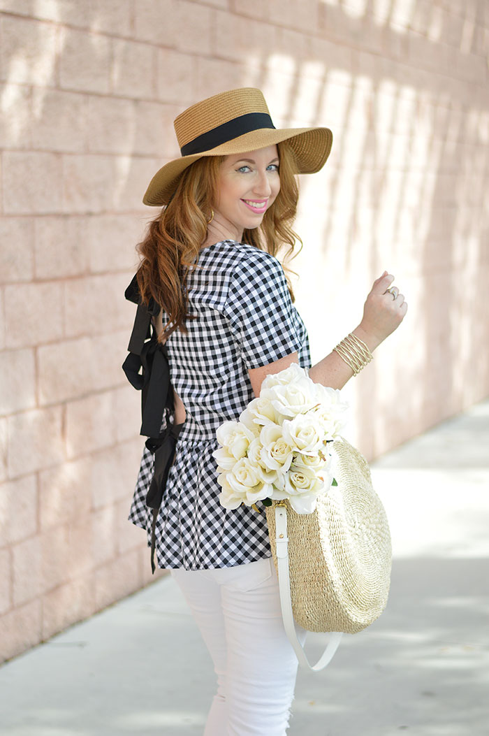nina lacher from law of fashion blog wears black and white checkered bow split back peplum top