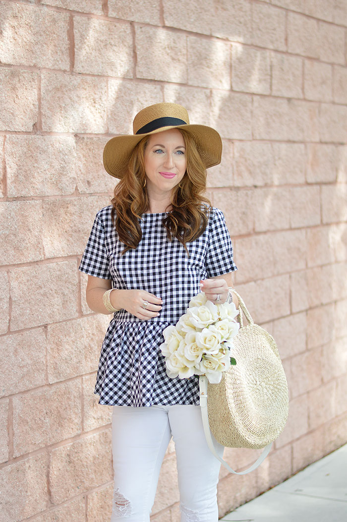 nina lacher from law of fashion blog wears black ribbon straw boaters hat