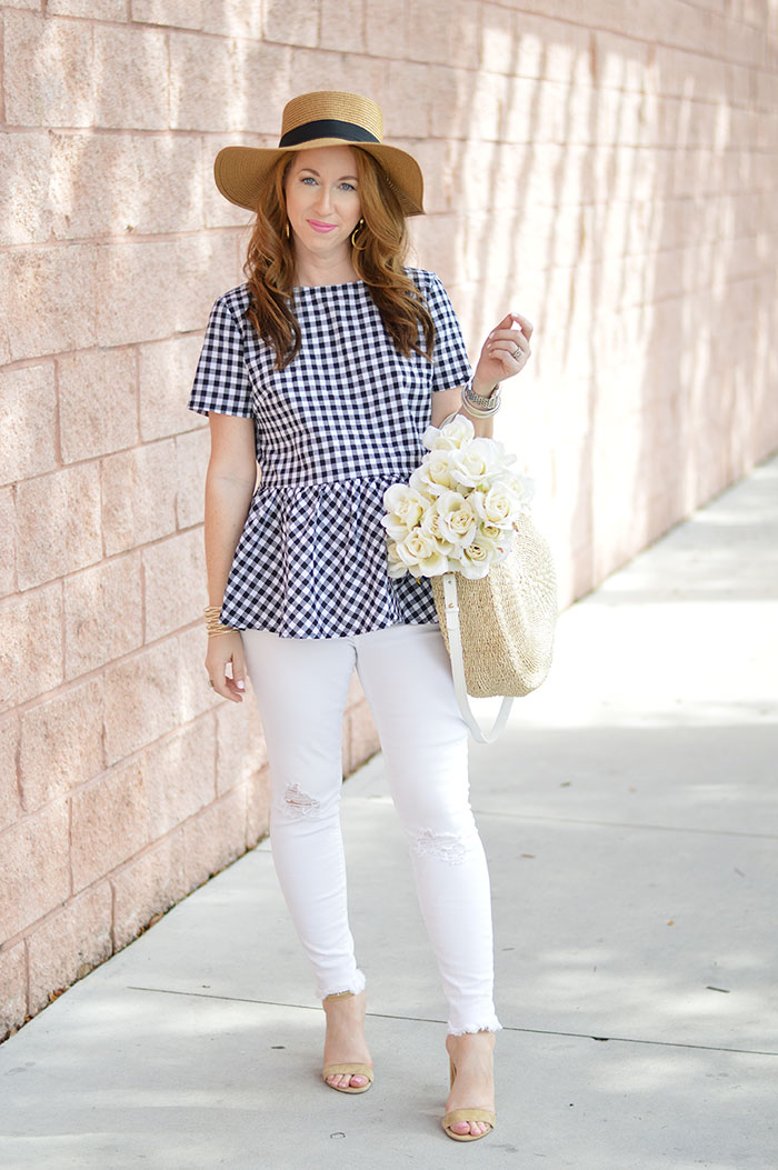 nina lacher from law of fashion blog wears round woven beach tote