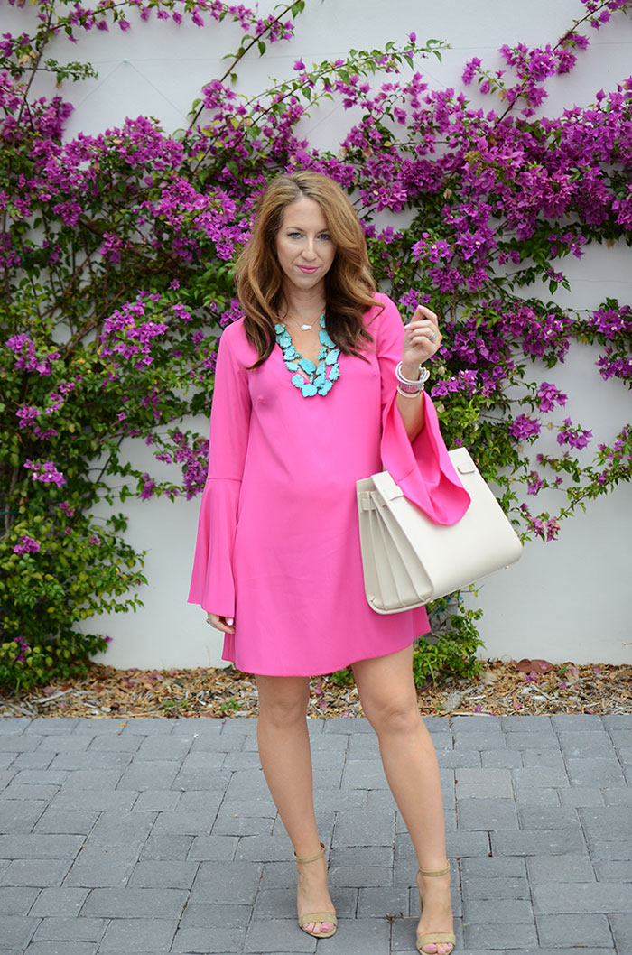 nina lacher from law of fashion blog wears topshop pink bell sleeve dress
