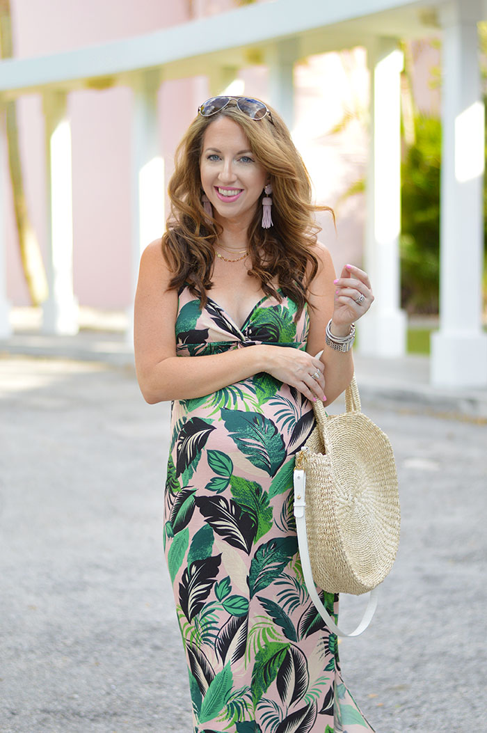 nina lacher from law of fashion blog wears pink palm tree maxi dress